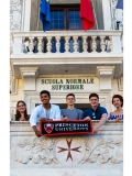 Study abroad to Pisa: Students holding a Princeton University Flag, While standing on a balcony.